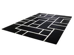 black and white geometrically shaped wool rug