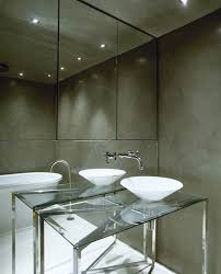 bathroom with mirrored accent wall