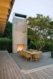 outdoor concrete patio contemporary with outdoor fireplace silver outdoor dining tables