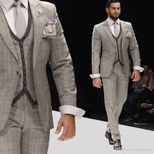 Cheap Mens Designer Suits 2019 Handsome Mens Designer Suits Light Grey Damier Check Three Pieces Peaked Lapel Groom Tuxedos Customized Best Man Business Men Suits Tux Jackets