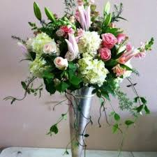 tall lilies and roses