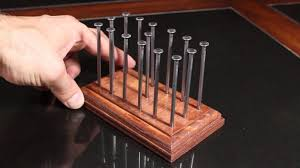 How To Make Wooden Games How To How Do You Balance 100 Nails on a Single Nailhead Find Out 24