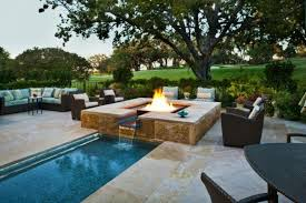 inground fire pit mediteranian pool teal diamond glass firepit corner couch rattan chairs square fire pit
