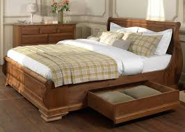wooden sleigh bed. Plain Sleigh Sleigh Beds With Storage Drawers On Wooden Bed