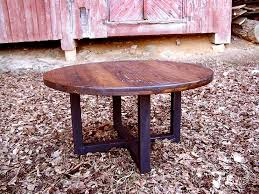 a custom made reclaimed wood wormy chestnut round coffee table with industrial metal base made to order from the strong oaks wood custommade com