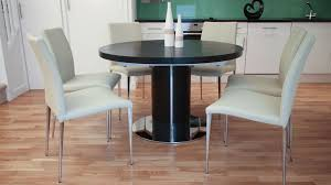 modern round extending dining table with a chrome base