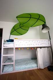 Ikea Hack : kura bed for two boys with white decor, lights and curtain on