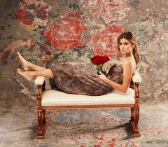 girl laying on bench in front of rug home furnishings model