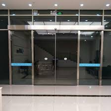 china pulley frameless glass automatic sliding door system