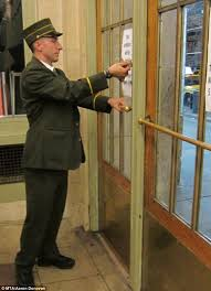 person locking door up assistant station master cory harris chains the doors of grand person locking door a69 locking