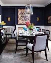 contemporary art keeps this clic dining room fresh love also love grcloth and chair rail and dining chairs house home magazine