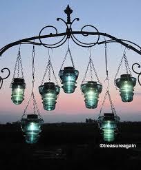 outdoor hanging solar chandelier surprise diy insulator hanger lantern tea light holder interiors 42