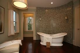 modern full bathroom with freestanding bathtub crown molding in