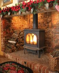 love the stove in a large fireplace