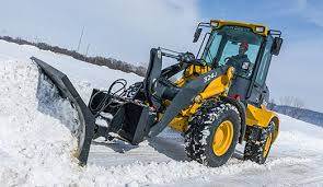 john deere snow plow attachment. Contemporary Attachment Tractor With Snow Pusher Attachment Clearing Snow In A Parking Lot To John Deere Plow Attachment P