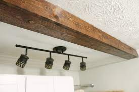 how to diy a faux wooden ceiling beam