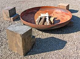 raised fire pits made from metal are one kind of outdoor fireplace