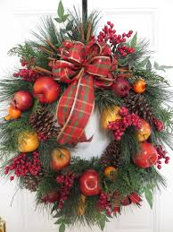 Christmas Wreath at Whitehall Cottage is traditionally Williamsburg-style  Fruit Wreath, Pinecones.