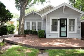 The house has light grey vinyl siding but lacks the craftsman detail. Does  anyone have
