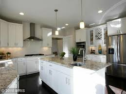 White Transitional Kitchens Kitchen With Hardwood Floors Undermount Sink Zillow Digs Zillow