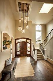 lighting in houses. seven rejuvenation stafford pendants in oil rubbed bronze with a combination of clear globe and tube shades dazzle the front foyer westlake development lighting houses h