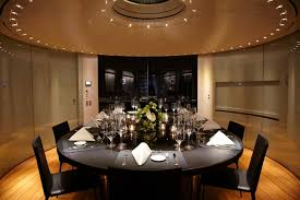 the yachts versatile arrangement includes a dining table that can become a coffee table semi a library period period period
