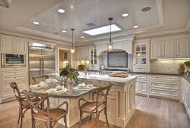 Eat in kitchen kitchen beach style with kitchen island under cabinet  lighting