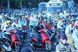 population growth  thousands of scooters make their way through the city of hồ chi minh vietnam