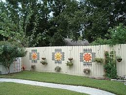 Decorate your damaged fence with some black plastic yard edging and outdoor  decor!