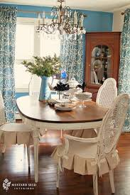 love the chair covers with white seat and tan linen colored ruffle bows are super cute too find this pin and more on painted dining room