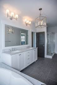 gray bathroom with white cabinets. white bathroom ideas, polished nickel fixtures, grey marble bath surround and countertops, gray with cabinets t