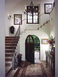 full image for old world spanish style entryway the arched doorway and wrought iron chandelier give