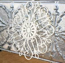 white outdoor metal wall art