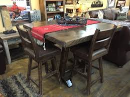 mtn alder solid knotty alder trestle pub table w double stacked chainsawed edge in light walnut