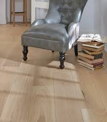 flooring engineered wood with grey leather chair for