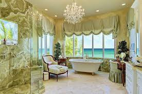 beautiful bathroom with ocean view from bathtub and shower with chandelier