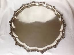 large round silver serving tray with contourned edge and shell decoration ca 1880