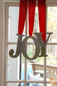 diy gift ideas decorated wooden letters hanging from ribbon