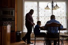Shelton Stroman  left  and his partner Christopher Inniss  right  help their son Jonathan     with homework in the couple     s kitchen in Snellville  Georgia The Atlantic