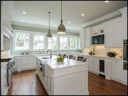 grey wall paint and white cabinets for kitchen decoration with wooden floor and recessed lighting ideas