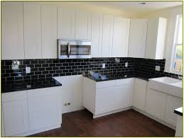 Classy Kitchen Backsplash Ideas With Black Tiles And Yellow Accent