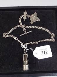 lot 212 a silver double watch chain with t bar and st john ambulance mount