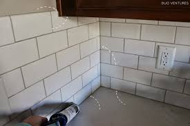 more specifically we needed to caulk any seams where the tile met the quartz countertops upper cabinets as well as the two corners of the backsplash