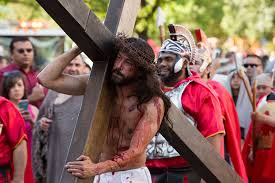 photo essay passion play draws hundreds to downtown san the actor portraying jesus christ carries his cross down houston street as spectators look on photo by scott ball