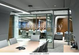 glass enclosed room meeting taking place in a seen from an opposite conference planet earth to glass enclosed