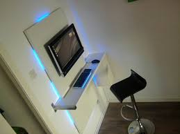 Minimalist Bedroom with Sleek Workstation Built Wall Mounted Computer Desk,  Blue String Lights Decoration,