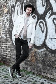 men s white leather biker jacket white short sleeve shirt black skinny jeans black leather low top sneakers men s fashion