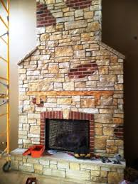 stone veneer over brick fireplace
