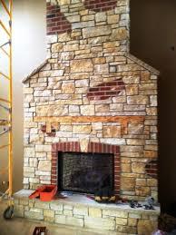 stone veneer over brick fireplace