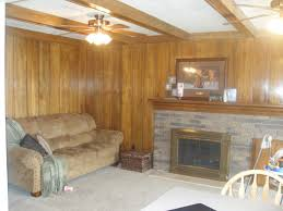 admirable family room with brown wall painted wood paneling decoration also brown sofa
